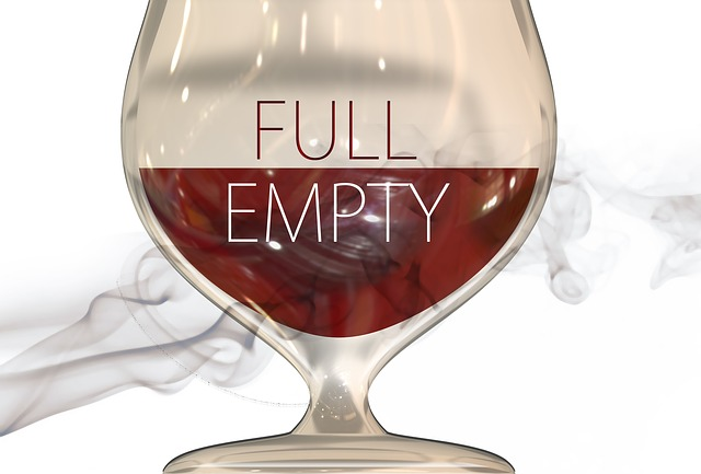 "a glass, filled halfway, with the halves labeled ""full"" and ""empty"""