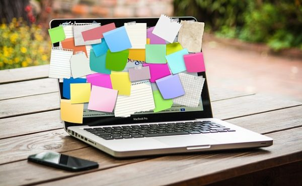 laptop covered in post-its