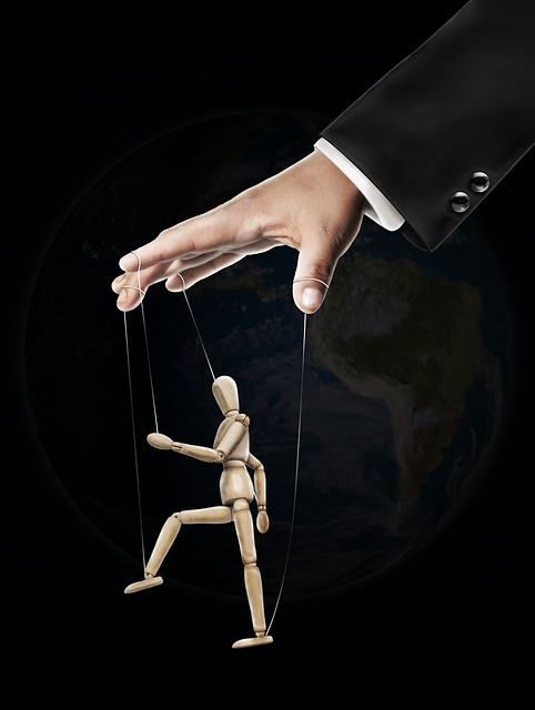 hand controlling a marionette